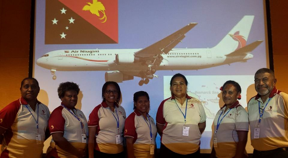 CV15 - PNG Group in Front of Plane Photo